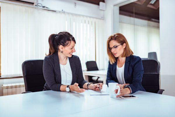 Two people meeting in conference room